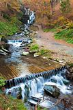 Waterfalls on Rocky Autumn Stream 