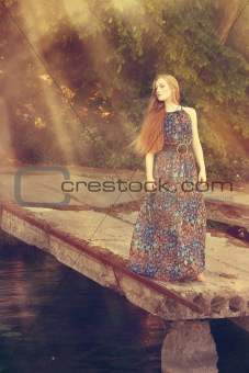 Blonde girl standing on dock