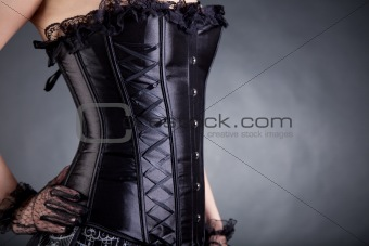 Close-up of woman in black corset