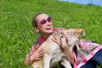girl playing with a puppy