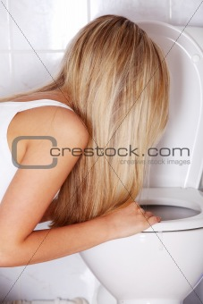 Young blond teen woman vomiting