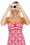 Woman holding a micro four thirds photo camera.