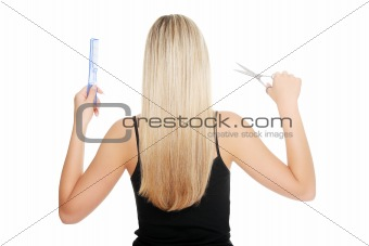 Young blond woman and hairdresser's tools