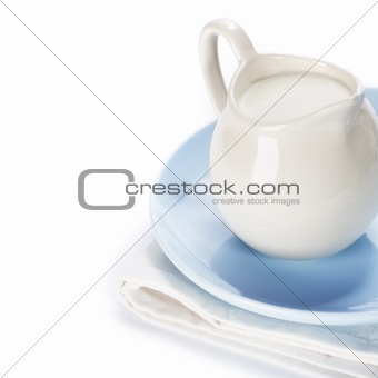 white ceramic jug with milk
