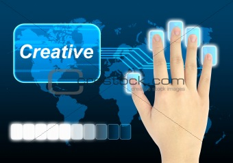 businessman hand pushing creative button on a touch screen interface