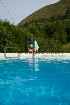 testing water on swimming pool border
