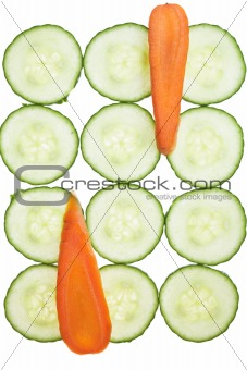 Carrot and cucumber slices arrranged in a pattern.