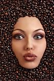portrait of a pretty girl laying among coffee beans