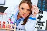 Thoughtful doctor woman in laboratory analyzing results of medical test