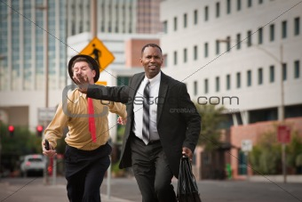 Businessmen In A Rush