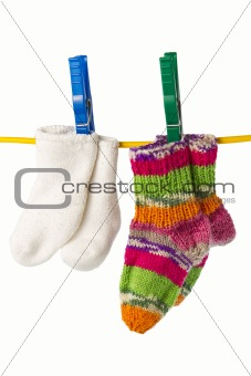 four socks on a clothesline