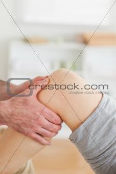 Guy massaging a lying woman's knee