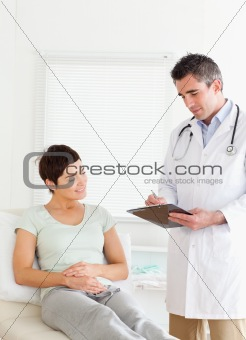 Cute Woman lying down talking to a doctor