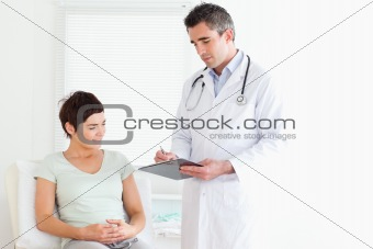 Charming Woman lying down talking to a doctor