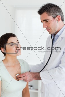 Close up of a Doctor examining a brunette woman