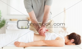 Charming Woman relaxing during a back-massage