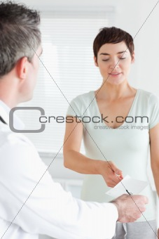 Young Woman receiving a prescription