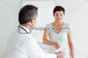 Beautiful Woman receiving a prescription