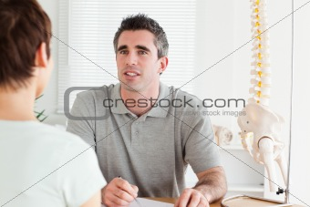 Doctor and patient sitting at a table talking