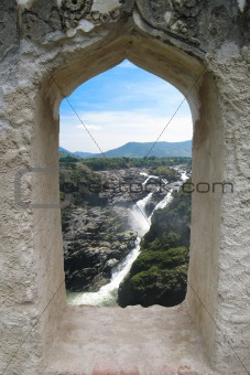 Waterfall through a fort window