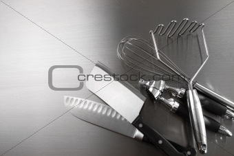 Kitchen utensils on stainless steel