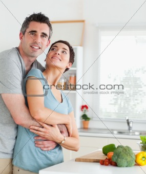 Happy husband and wife hugging