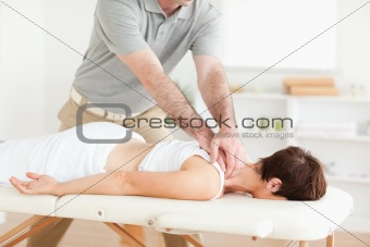 Guy massaging a cute woman's neck