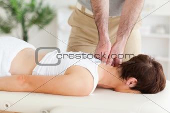 Masseur massaging a customer's neck