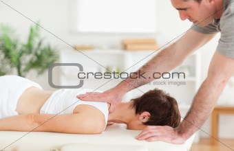 A masseur massaging a woman&#39;s back