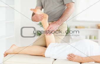 A woman's leg being massaged