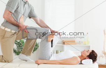Chiropractor working with a woman