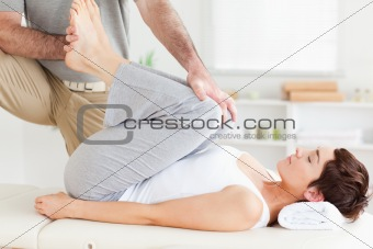 Chiropractor stretching a woman's legs