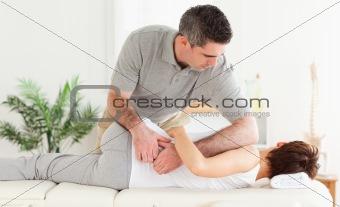 Masseur massaging a customer