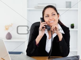 Beautiful businesswoman on telephone