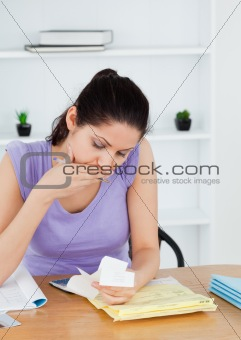Shocked young woman accounting