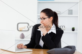 A serious young businesswoman in her office