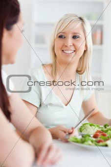 Close up of Smiling Women eating salad