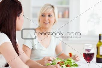 Portrait of happy Women eating salad