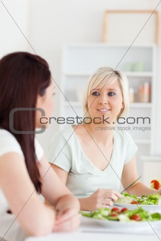 Portrait of joyful Women eating salad