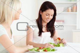 Portrait of beautiful Women eating salad