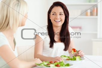 Portrait of laughing Women eating salad