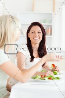 Portrait of gorgeous Women eating salad