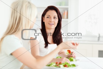 Portrait of young Women eating salad