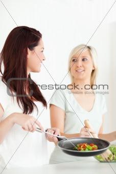 Cute Women cooking dinner