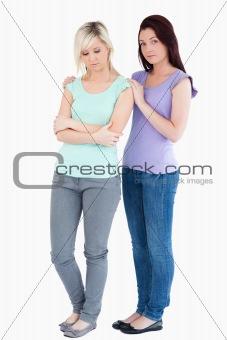 Cute Woman comforting sad friend