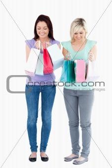 Cute women with shopping bags