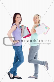 Joyful women with shopping bags