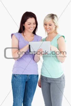 Charming women with a tablet