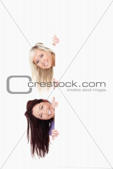 Charming Women peeking around a banner
