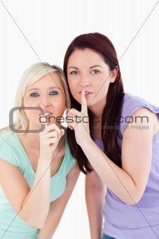 Charming women hushing